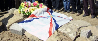 Assyrian flag over the grave of a martyr in Ashur