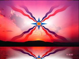Assyrian flag at sunset at the far side of a lake and a mountain range